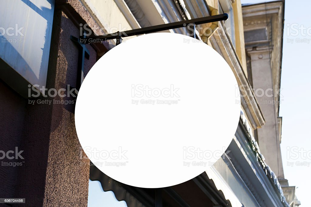 Round shape signboard on wall. Mock up. stock photo
