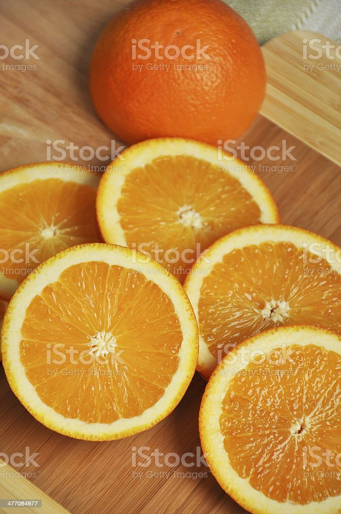 Round slices of orange on a cutting board stock photo