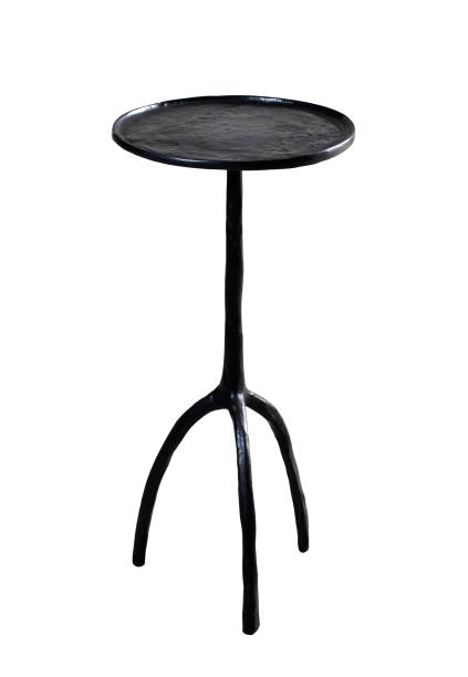 Round steel forged small table isolated on white background. Clipping path. stock photo