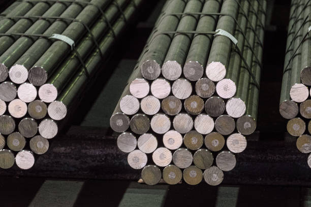 Round steel section rolling profile in stacked. Warehouse of metal products. Round steel section rolling profile in stacked. Warehouse of metal products. rod stock pictures, royalty-free photos & images