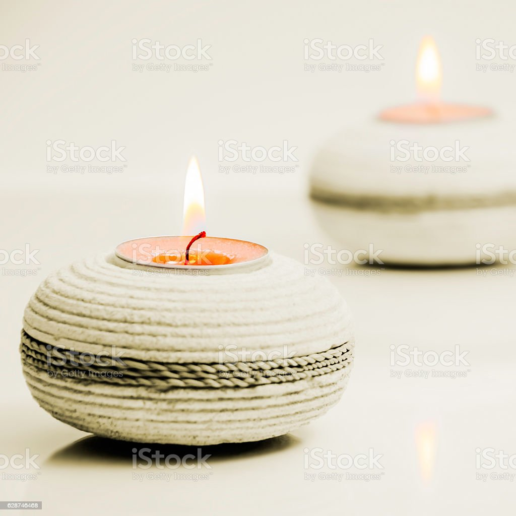 Round stone tea light holders spa concept square stock photo