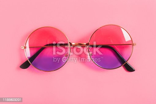 istock Round summer duotone sunglasses on pink background. 1155803201