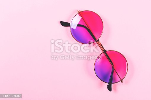 istock Round summer duotone sunglasses on pink background. 1157128057