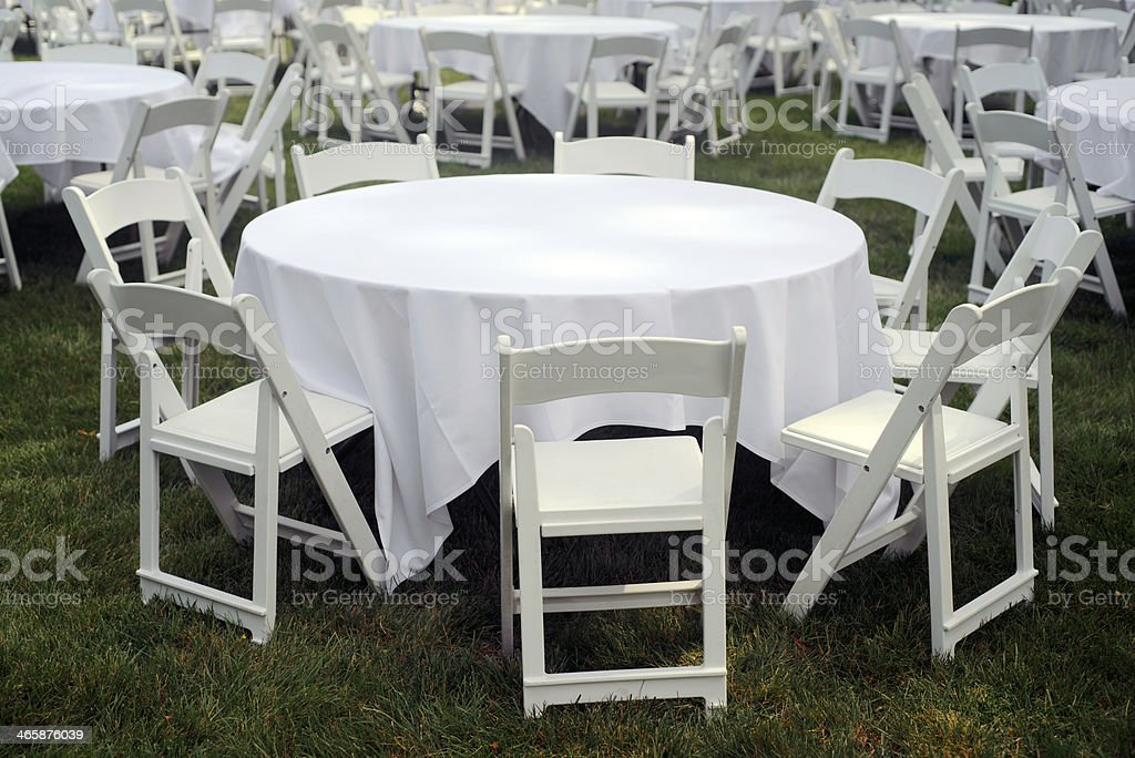 Round table and folding chairs at reception stock photo