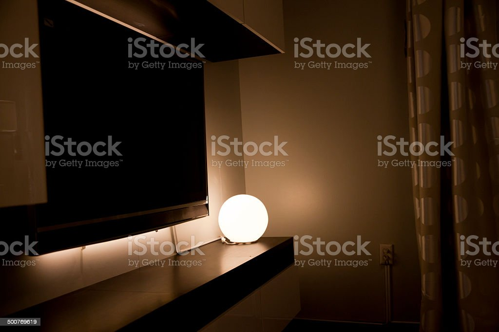 Round table lamp in the dark living room
