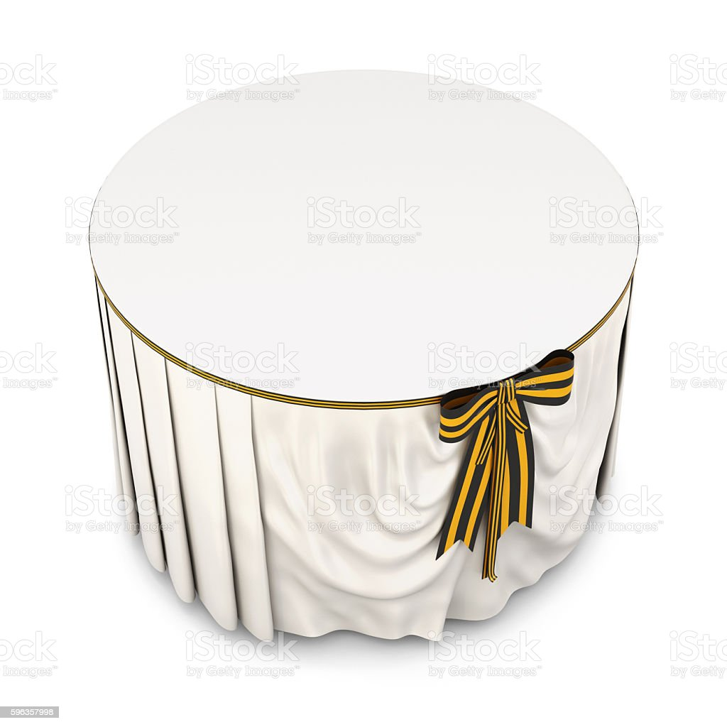 Round table with tablecloth and bow on a white background. stock photo