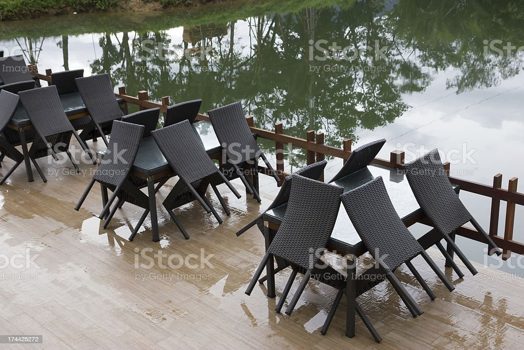 Round tables and wicker chairs royalty-free stock photo