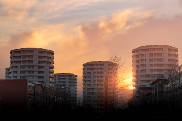 Round tower appartments in the sunset stock photo
