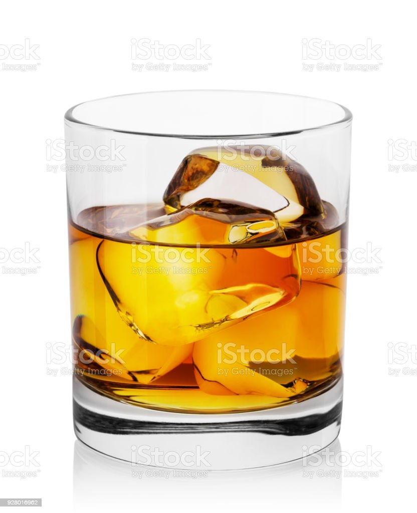Round transparent glass of whiskey with ice royalty-free stock photo