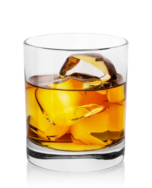 round transparent glass of whiskey with ice - whiskey stock photos and pictures
