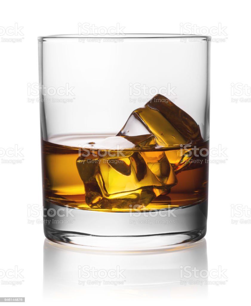 Round transparent glass of whiskey with ice stock photo