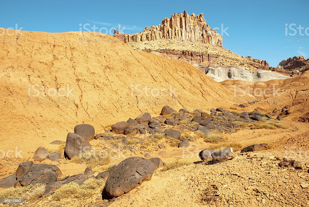 round volcanic boulders on a hillside below the Castle butte stock photo