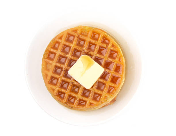 Round Waffles Ready for Breakfast on a White Background Round Waffles Ready for Breakfast on a White Background waffle stock pictures, royalty-free photos & images
