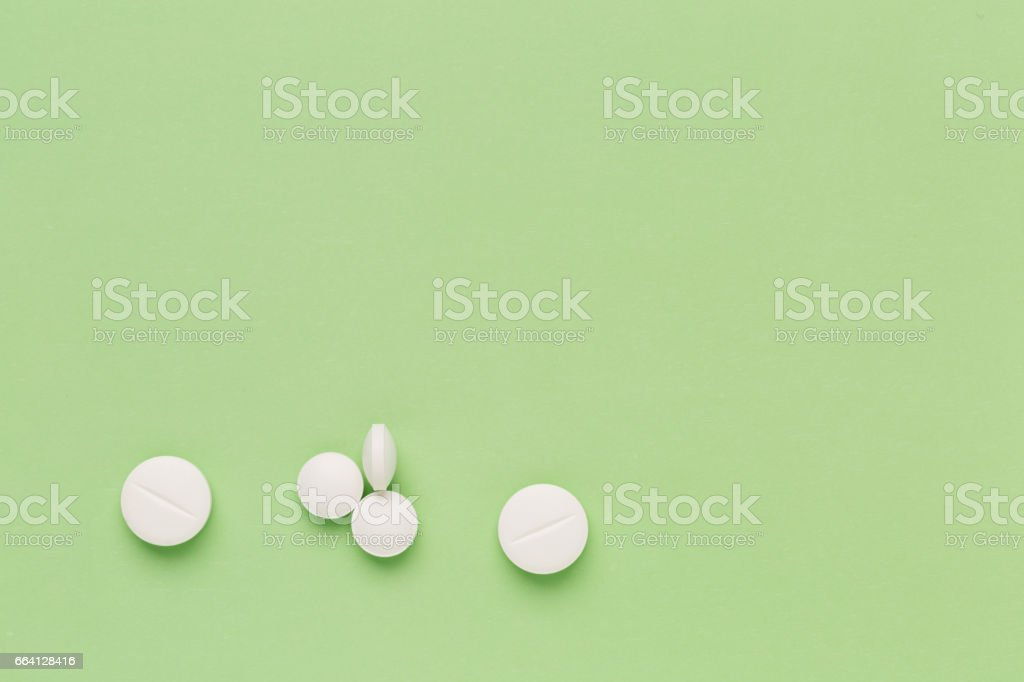 Round white pills on colorful background foto stock royalty-free