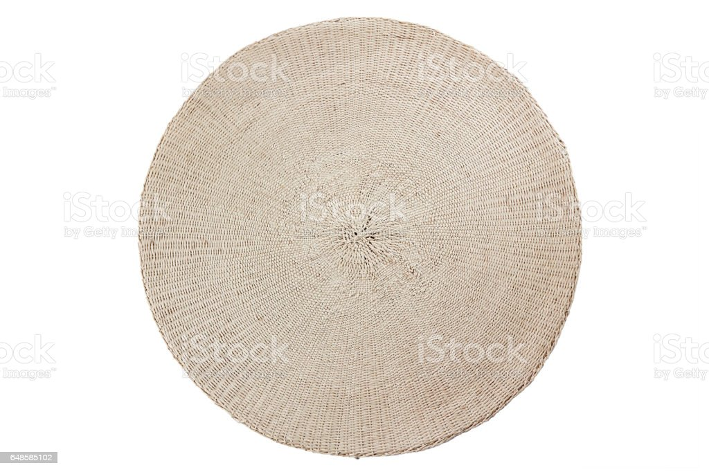 Round wicker placemat on white stock photo