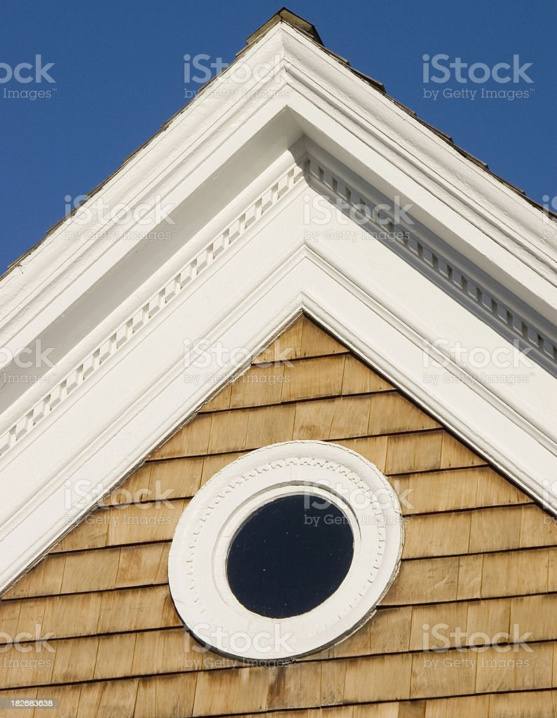 Round window and peaked roof stock photo