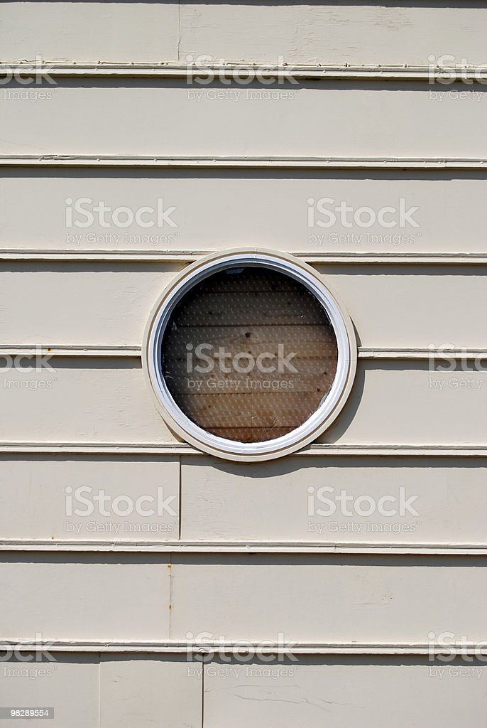 Round window in wall royalty-free stock photo