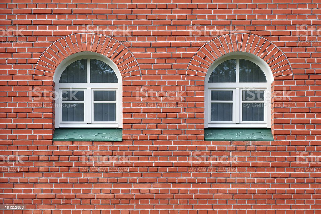 Round windows on the wall of brick royalty-free stock photo