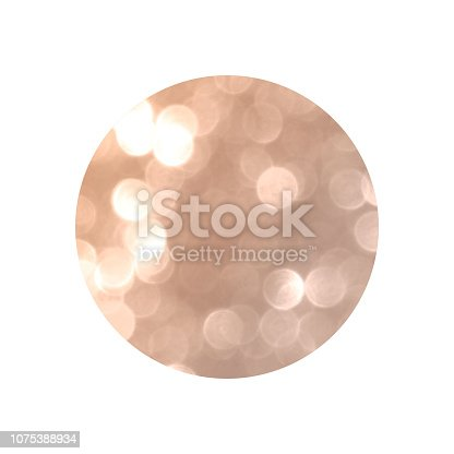 istock Round with rose gold glitter bokeh lights isolated on white background. 1075388934
