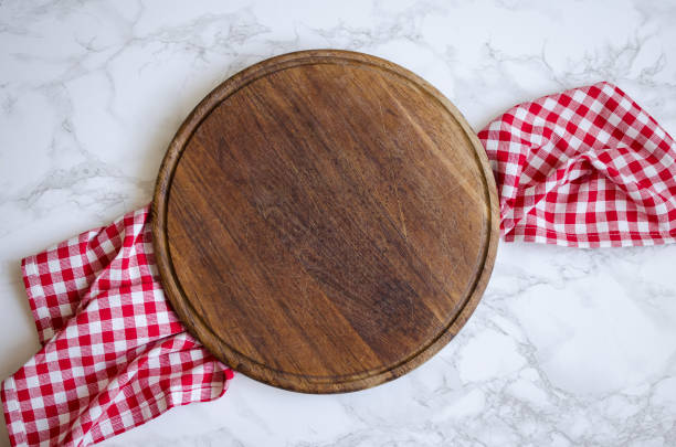 Round wooden cutting board stock photo