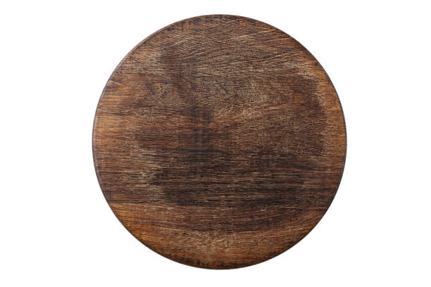 round wooden pizza board stock photo