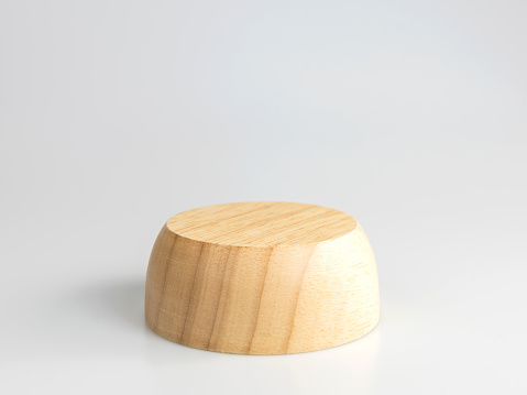 Round wooden plinth isolated on a white background with clipping paths. Used to display products.