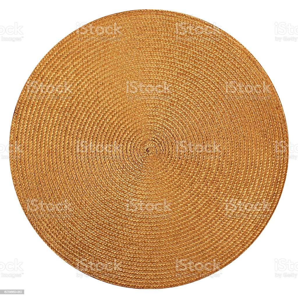 Round woven straw mat isolated on white background stock photo