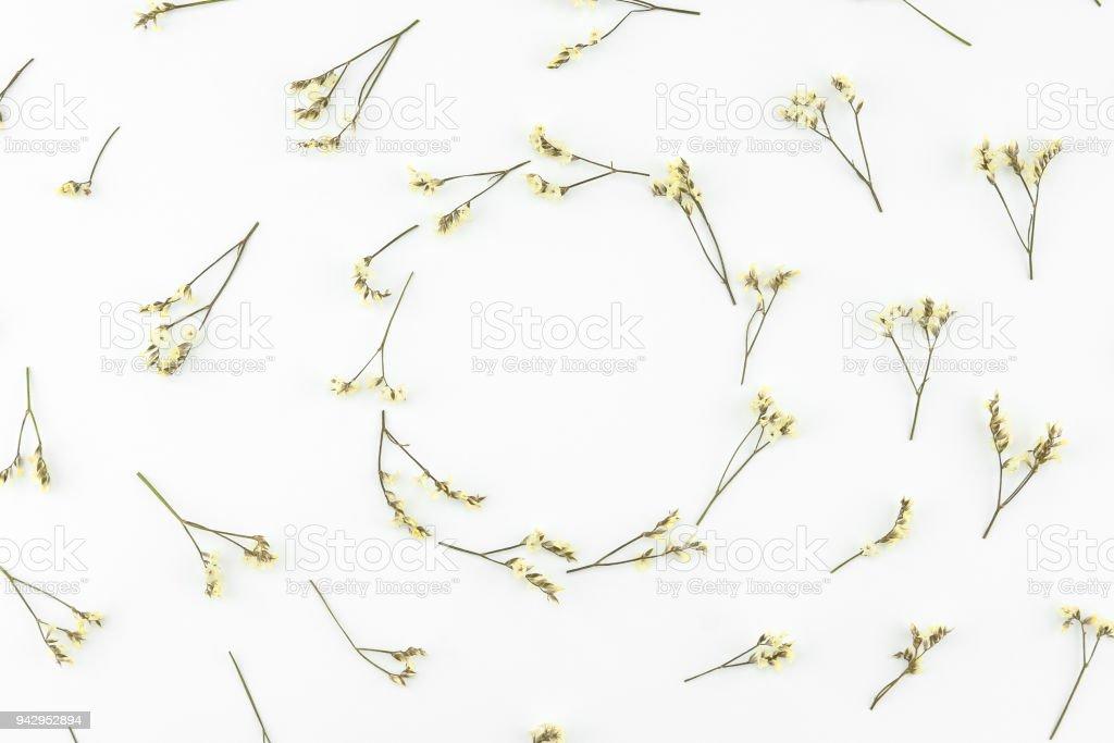 Round wreath made from yellow limonium caspia flowers stock photo