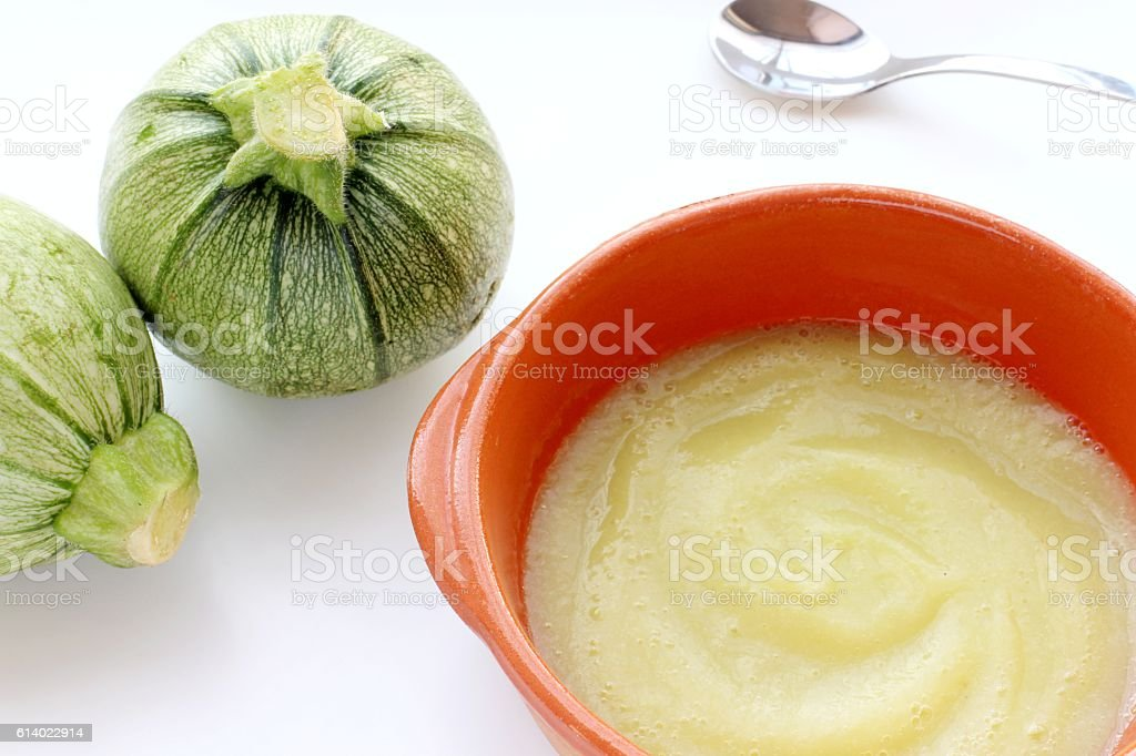 Round zucchini baby food puree stock photo