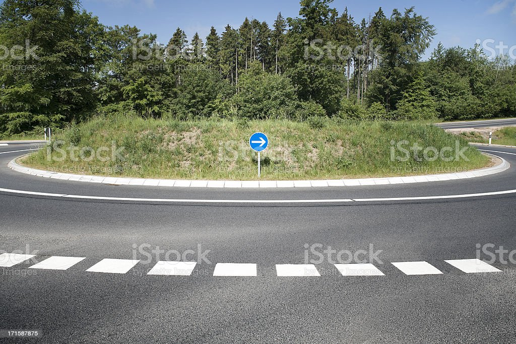 Roundabout, country road stock photo