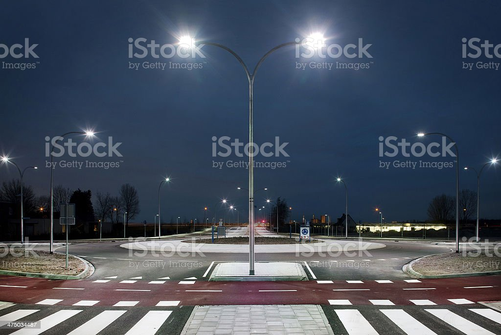 Roundabout illuminated by led lights  at twilight stock photo