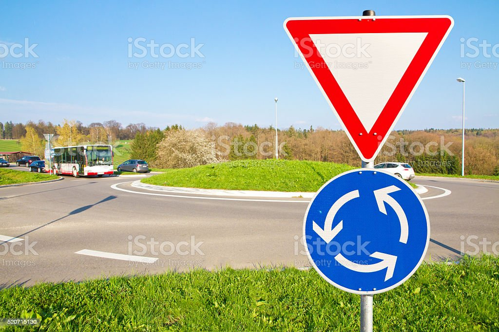 Roundabout road warning stock photo