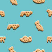 istock Rounded fresh crispy cookies on light blue background. Seamless texture. Top view 1187184860