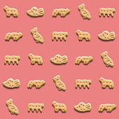istock Rounded fresh crispy cookies on pink background. Seamless texture. Top view 1187184831