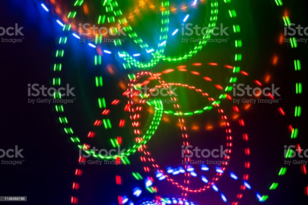 Rounded Intermittent Colorful Neon Glowing Strokes On Black Background As Wallpaper Stock Photo Download Image Now Istock