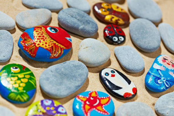 rounded stones from sea vacation painted souvenir made by kid picture id