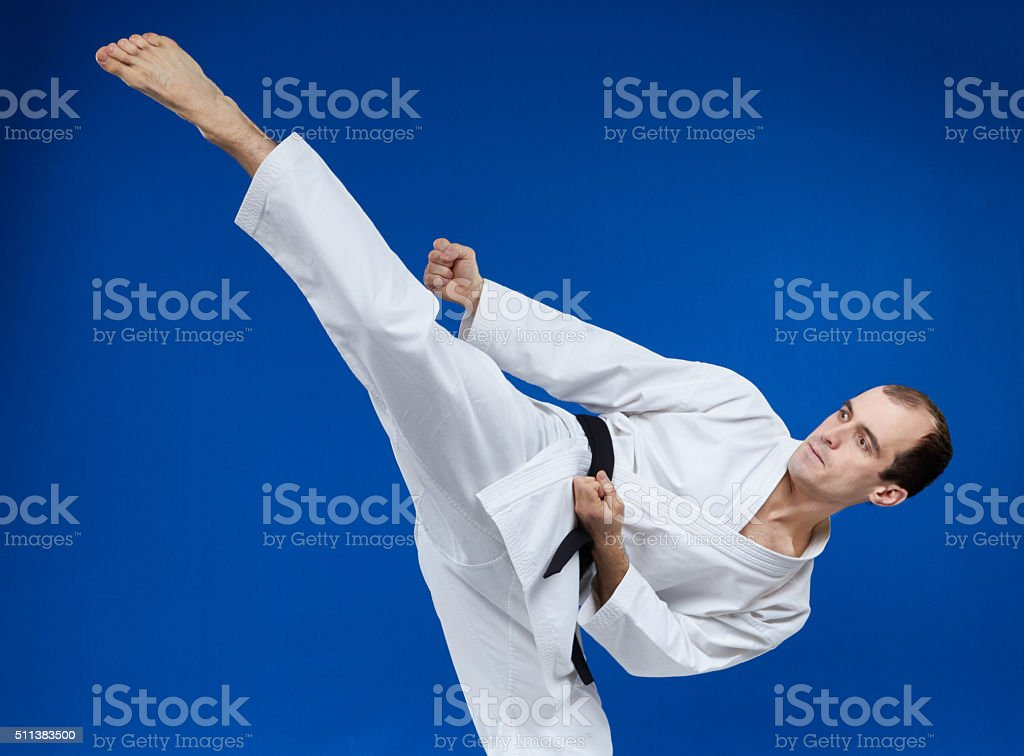 Roundhouse kick making the athlete stock photo