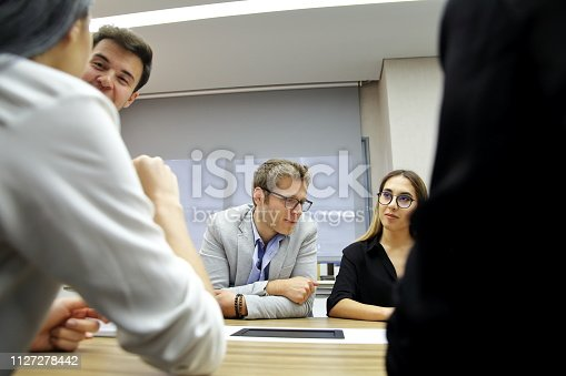 istock roup of business persons in discussion 1127278442