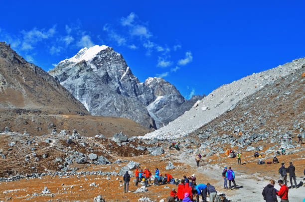 roup of hikers  with backpacks   on the trek in Himalayas, trip  to the base camp Everestd stock photo