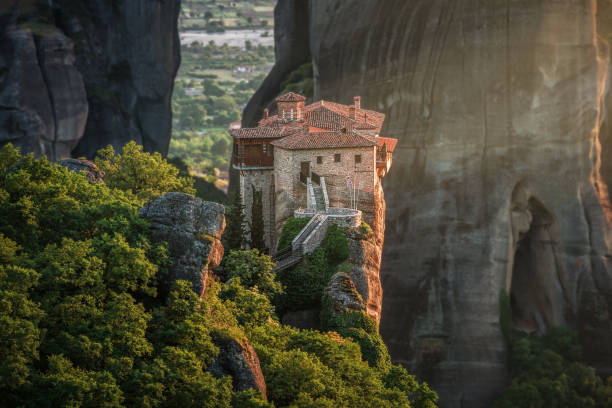 Roussanou monastery at Meteora at sunset Meteora, Greece abbey monastery stock pictures, royalty-free photos & images