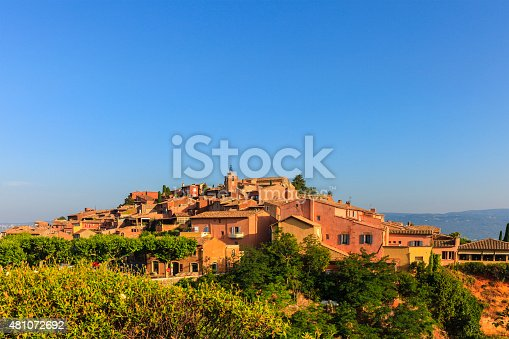 Roussillon is a true marvel of colors, well known as one of the most beautiful villages in France. The narrow streets of the old town are lined with houses painted in many shades of ocher and red, that shine at sunset. Provence-Alpes-Côte d'Azur region, southeastern France.