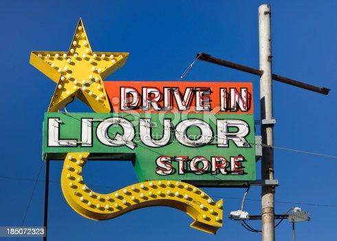 istock Route 66 Americana Drive in Liquor Store Neon Sign 185072323