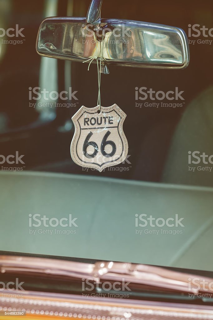 Route 66 badge hanging on a car mirror stock photo