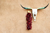 Route 66, Cow Skull and Chili Peppers on Stucco Wall