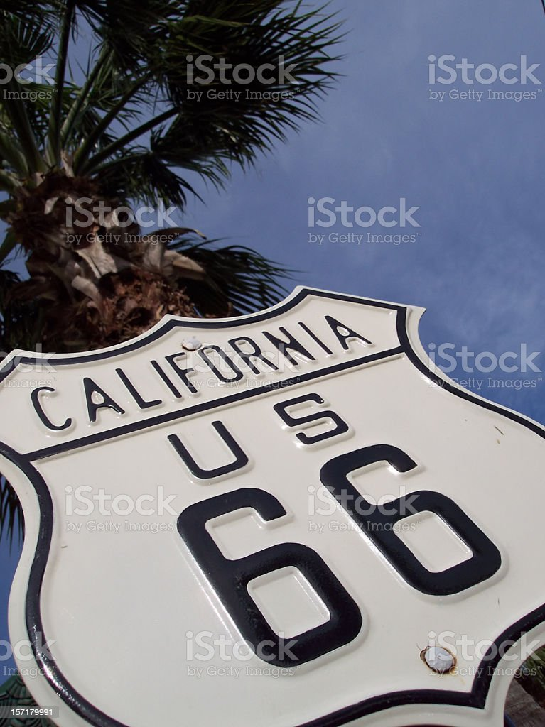 Route 66 Highway Sign Under Palm royalty-free stock photo