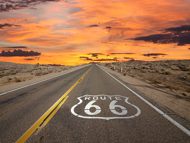 Route 66 Pavement Sign Sunrise Mojave Desert Route 66 pavement sign sunrise in California's Mojave desert. san bernardino california stock pictures, royalty-free photos & images