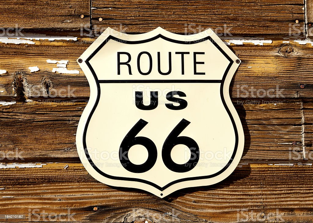 Route 66 road sign on old wooden barn. stock photo