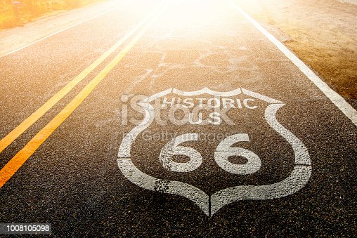 Route 66 sign on asphalt road