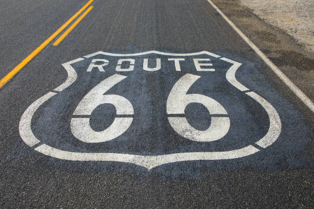 Route 66 sign on empty road in California, United States stock photo