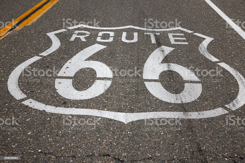 Route 66 Sign Painted on Empty Road royalty-free stock photo